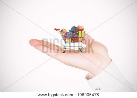Hand presenting against trolley full of gifts
