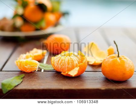 Fresh tangerines on a wooden table blue, sea, water background