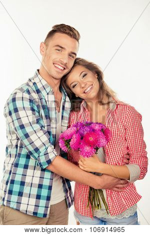 Handsome Young Man Giving A Bouquet To His Cute Beloved And Embracing Her