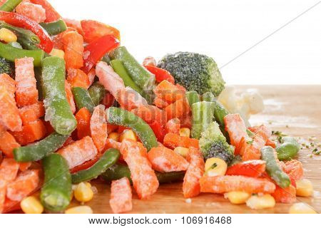 Heap Of Frozen Vegetables Isolated On White Background