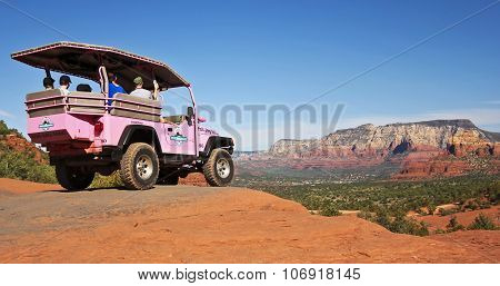 A Red Rocks Tour Jeep, Sedona In The Distance