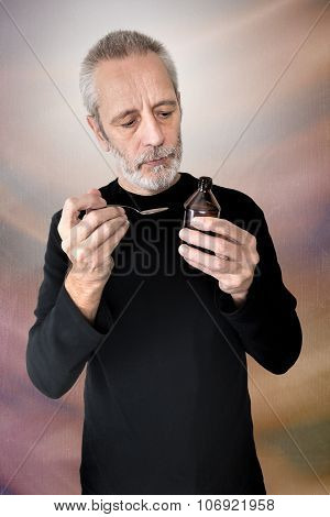 Man Reading Cough Syrup Label