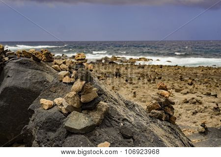 Stone Piles At The Shore
