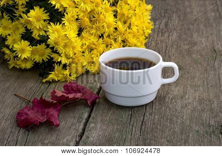Bouquet Of Yellow Flowers, Red Leaf And Coffee