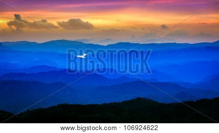 Panorama of sunset landscape in mountains. Munnar, Kerala, India