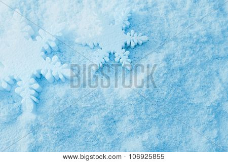 snowflake christmas ornaments and snow