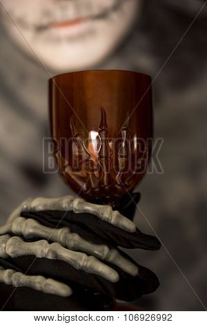 Skeleton Holding A Red Goblet
