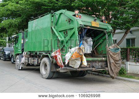 Ashman Loads Garbage Into A Truck