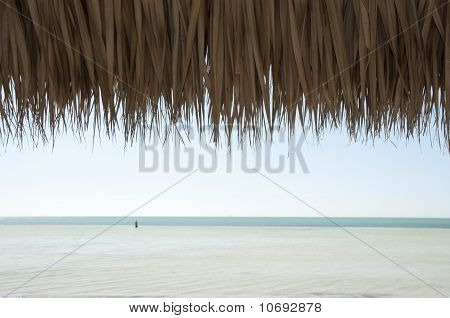 View Of The Ocean From Under Tiki Hut Roof