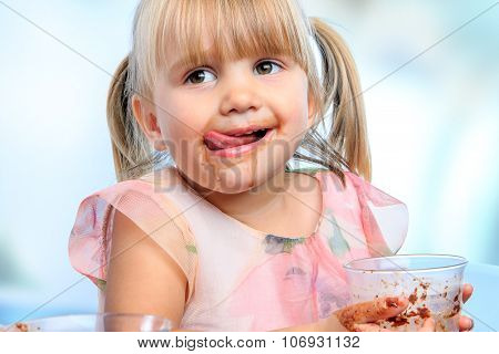 Little Girl Drinking Chocolate Milk At Home.