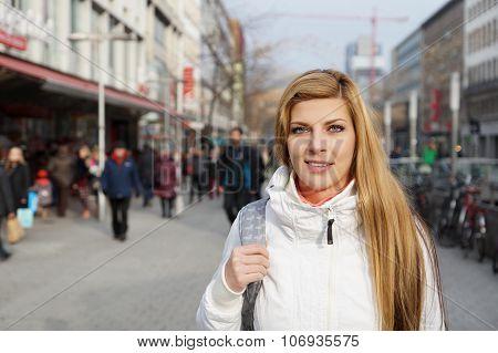 woman walking pedestrian street