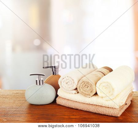 Soft towels with dispenser in bathroom