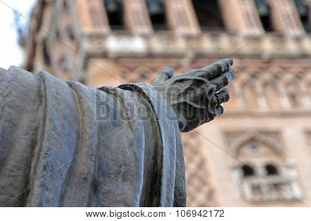 Statue Hand In Front Of Giralda Tower