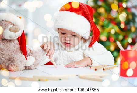 Child Before Christmas Writes A Letter To Santa