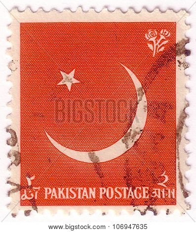Pakistan - Circa 1961: A Stamp Printed In Pakistan Shows Star And Crescent Moon, Circa 1961.