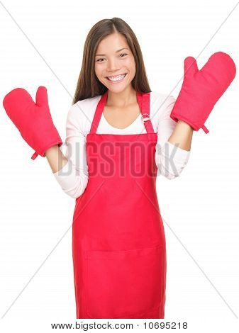 Cute Smiling Young Housewife With Cooking Mittens Isolated