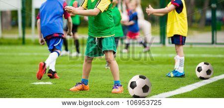 Children soccer football training. Kids playing football soccer match