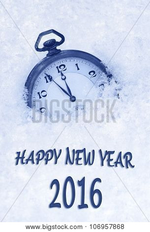 Happy New Year 2016 greeting in English language pocket watch in snow