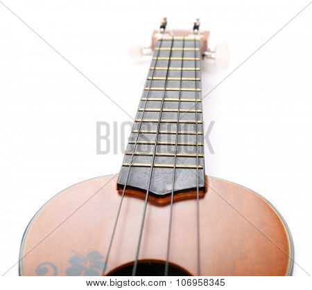Head and neck part of the Hawaiian acoustic guitar isolated on white