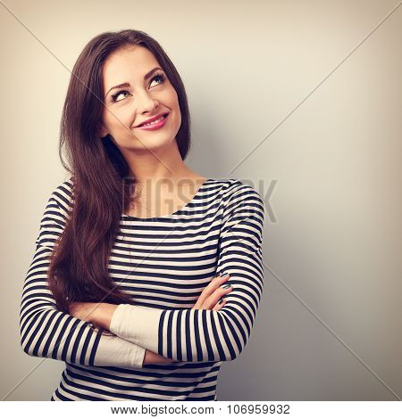 Happy Thinking Casual Girl With Folded Hands Looking Up. Closeup Vintage Portrait