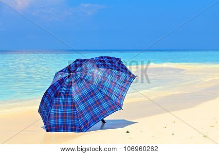 Blue Umbrella Is On A Beach