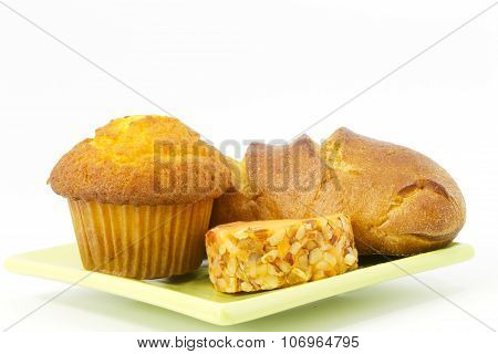 Corn Muffin, Baked Bread, And Cheddar Cheese