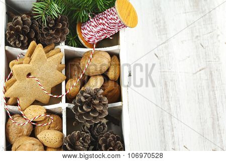 Christmas Cookies, Walnuts, Nuts And Pine Cones In Wooden Box.