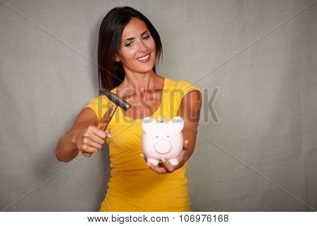Smiling Youngster Breaking Moneybox With Hammer
