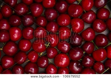 Fresh red cherry texture, top view