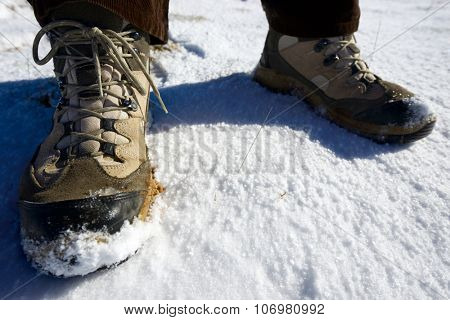 Closeup of hiking boots in the snow.