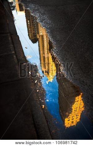 Streets Of Manhattan. Skyscrapers Reflection In Puddles
