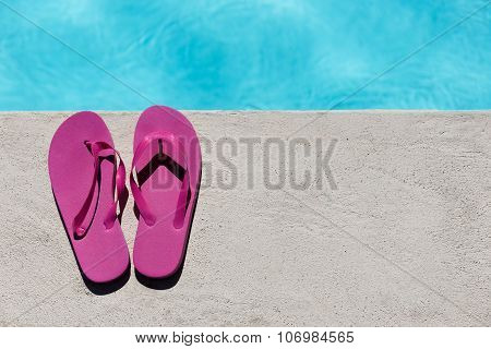 Pink Slippers Near Swimming Pool
