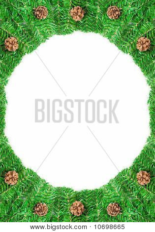 Christmas green framework with Pine needles and cones  isolated on paper textures background
