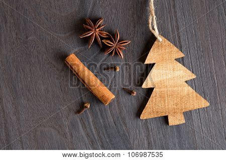 Wooden Christmas Tree On Wooden Background And Anise
