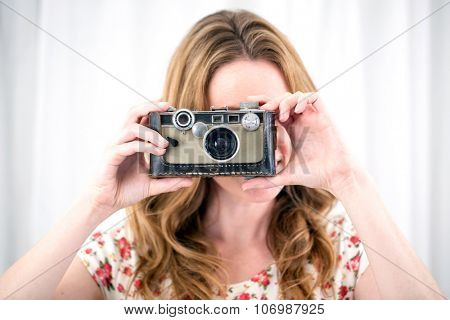 Young woman using her antique camera