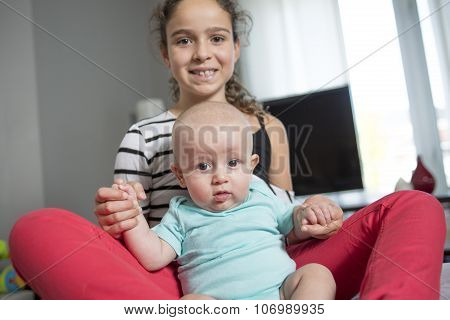 4 month old baby boy with is sister