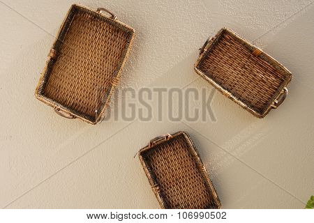 Three baskets hanging on the wall