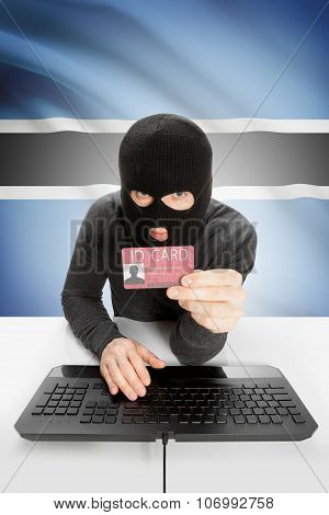 Hacker With Flag On Background Holding Id Card In Hand - Botswana