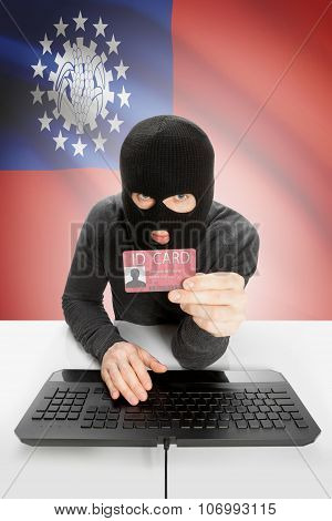 Hacker With Flag On Background Holding Id Card In Hand - Burma