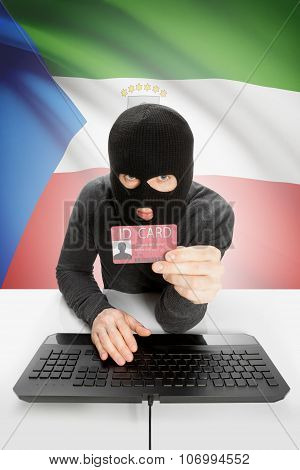 Hacker With Flag On Background Holding Id Card In Hand - Equatorial Guinea