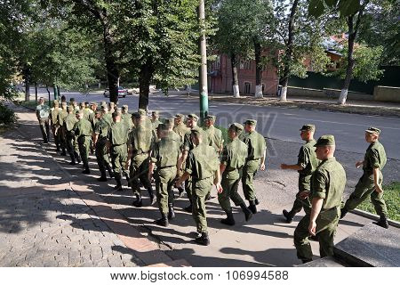Platoon Of Soldiers Going Through The City