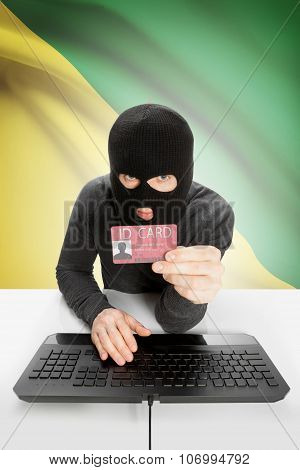 Hacker With Flag On Background Holding Id Card In Hand - French Guiana