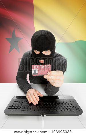 Hacker With Flag On Background Holding Id Card In Hand - Guinea-bissau