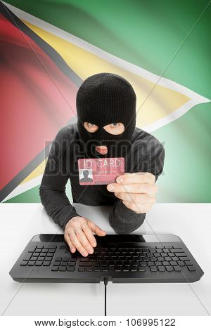 Hacker With Flag On Background Holding Id Card In Hand - Guyana