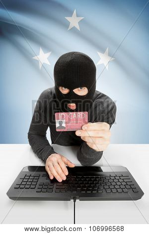 Hacker With Flag On Background Holding Id Card In Hand - Micronesia