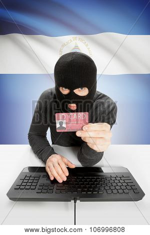 Hacker With Flag On Background Holding Id Card In Hand - Nicaragua