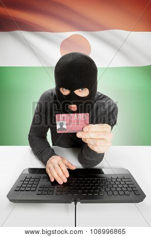Hacker With Flag On Background Holding Id Card In Hand - Niger