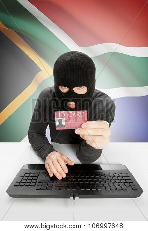Hacker With Flag On Background Holding Id Card In Hand - South Africa