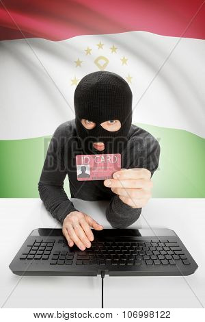 Hacker With Flag On Background Holding Id Card In Hand - Tajikistan