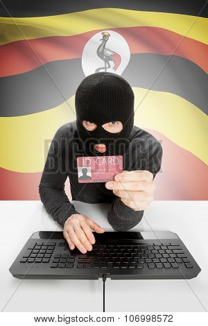 Hacker With Flag On Background Holding Id Card In Hand - Uganda